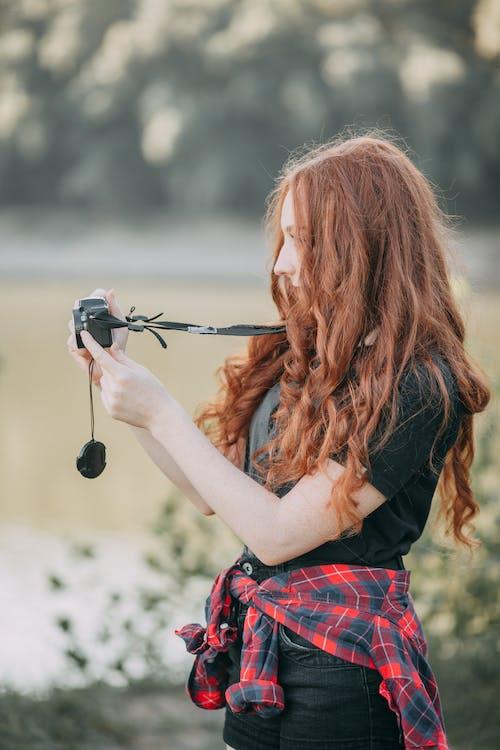 Photo Of Woman Holding Black Camera