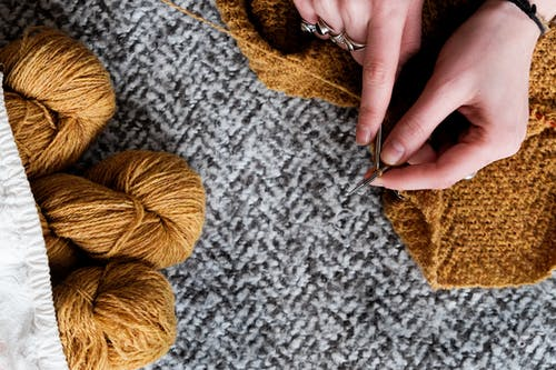 Photo Of Person Holding Wool