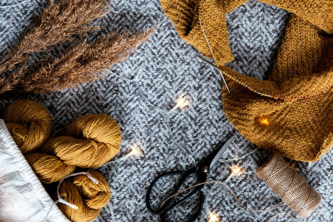 Sewing Materials on Gray Textile