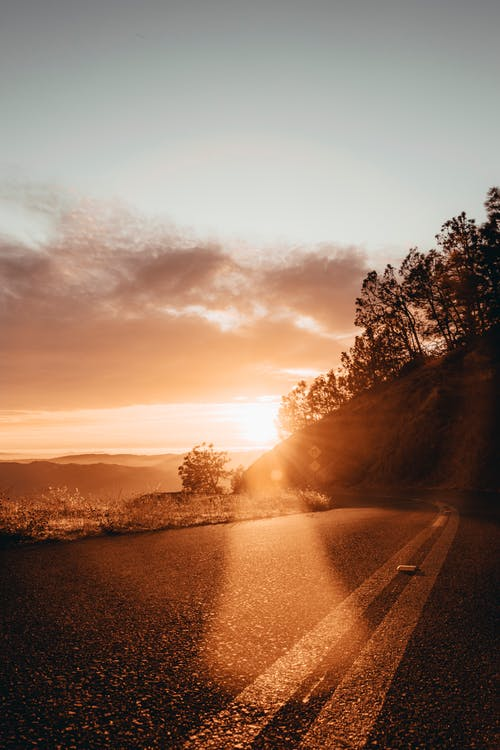 Photo Of  An Empty Road During Dawn