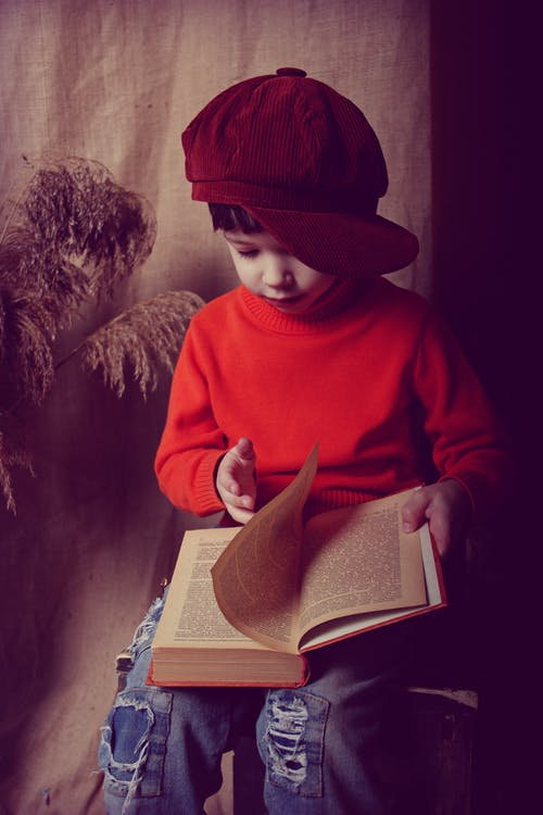 Photo Of Boy Wearing Red Cap