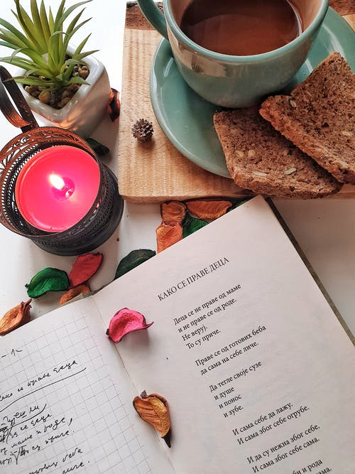 Photo Of Candle Near Book