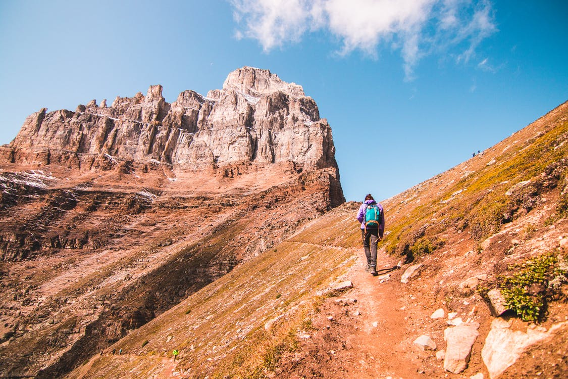 Photo of Person Hiking During Daytime