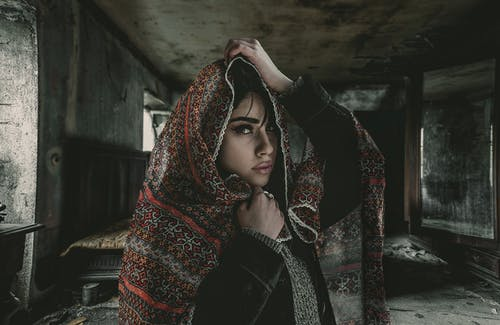 Woman in Red and Brown Scarf