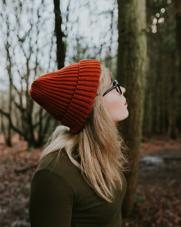 Woman in Red Knit Cap and Brown Sweater