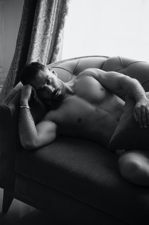 Naked Man Lying on Couch