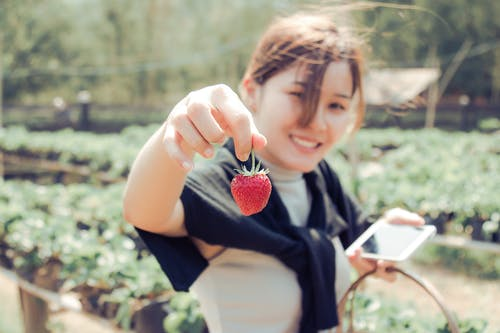 Woman Holding Strawberry