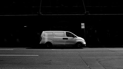 A Gray Scale Photo Of A Van