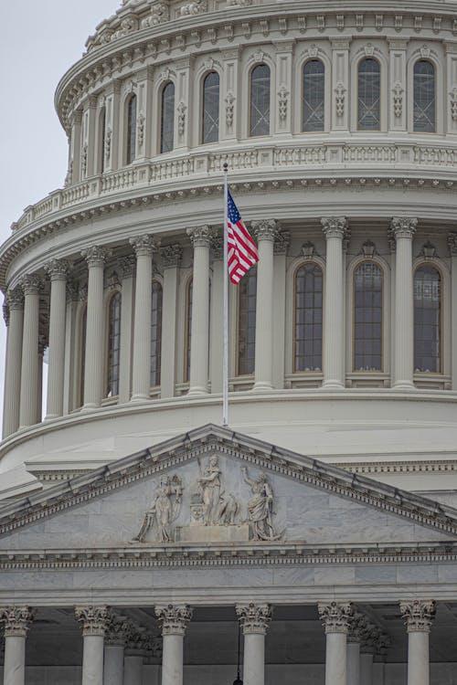 Gratis arkivbilde med amerikansk flagg, bakgrunnsbilde, bygning