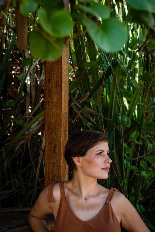 Photo Of Woman Wearing Brown Top