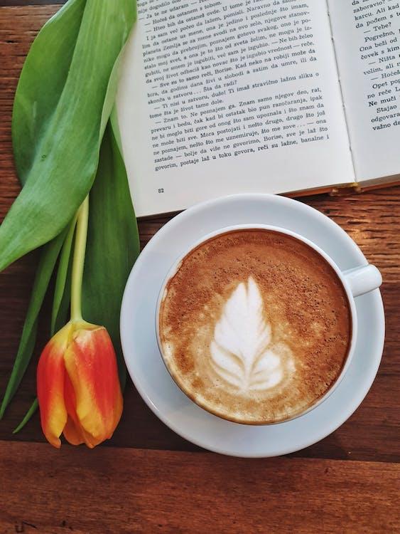Photo Of Mug Beside Book