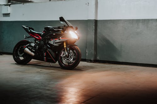 Photo of Parked Black and Red Triumph Daytona Sports Bike