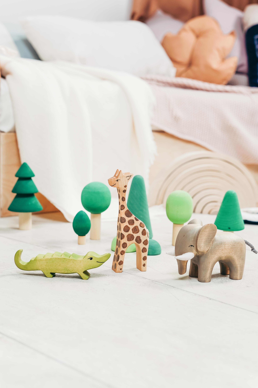 green crocodile wooden toy on the floor
