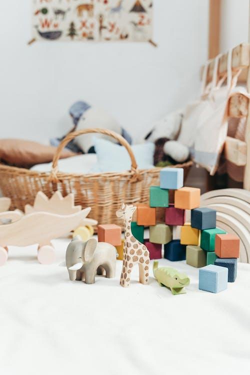 Brown Wicker Basket Near Colorful Blocks