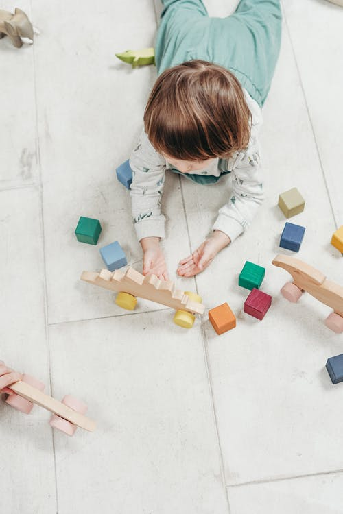 Baby playing with coloured blocks