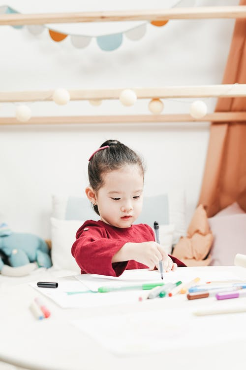Asian Girl Holding a Pen