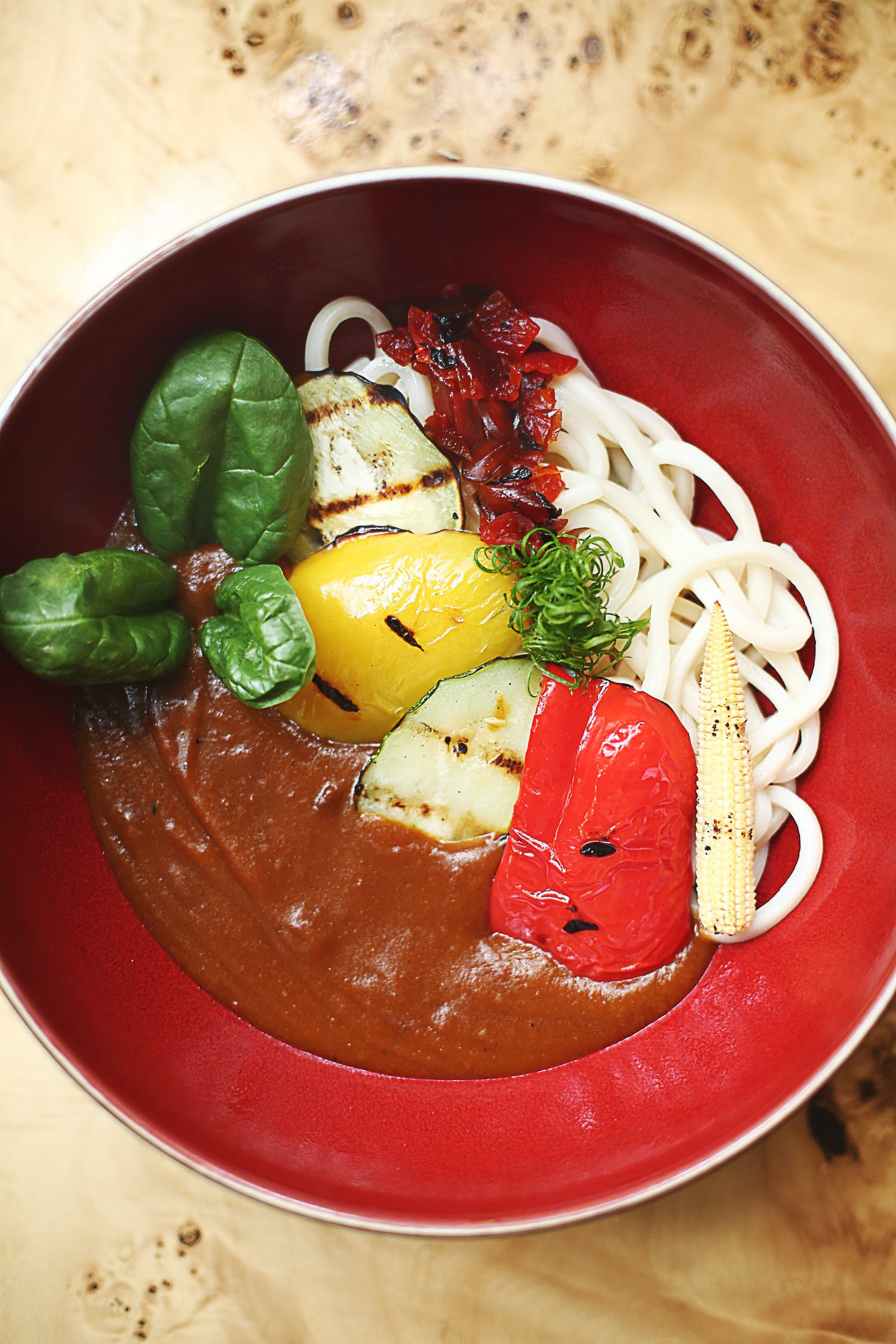 Pasta With Sauce and Green Vegetable on Red Bowl