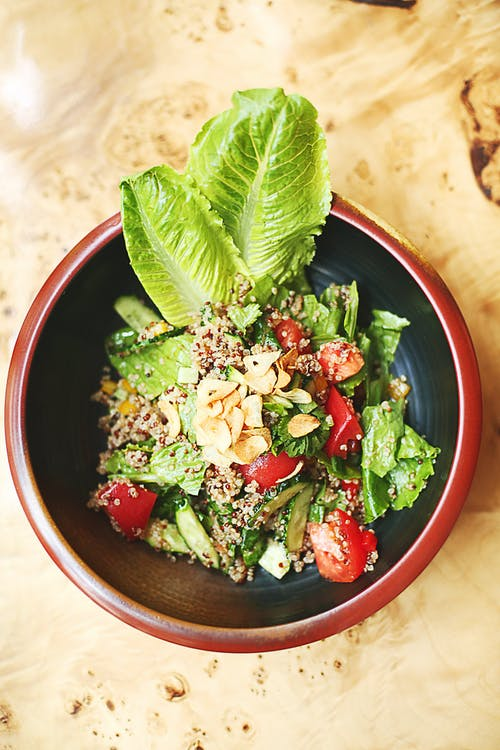 Green Vegetable Salad  on Red Bowl