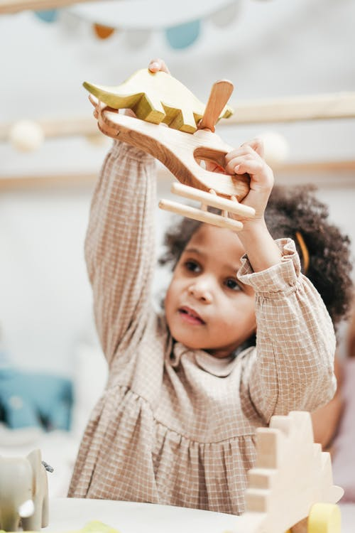 Girl Holding Wooden Toys