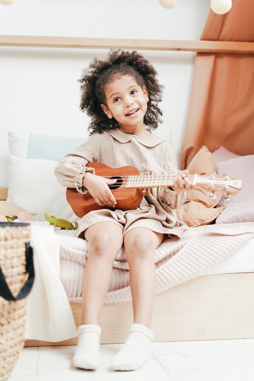 Photo of a girl Playing Ukulele