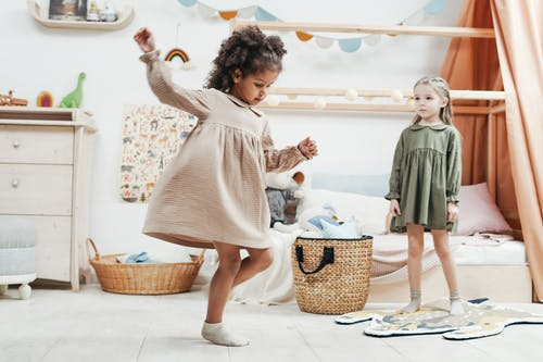 Photo of Girls Playing Inside the Playroom