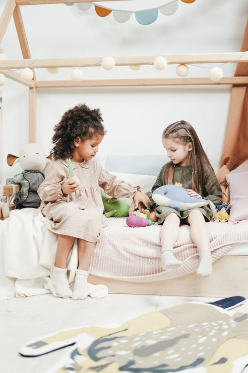 Photo of Girls Playing With Stuffed Toys