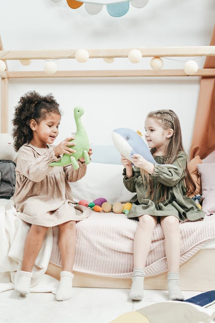 Photo of two girls playing with stuffed animals