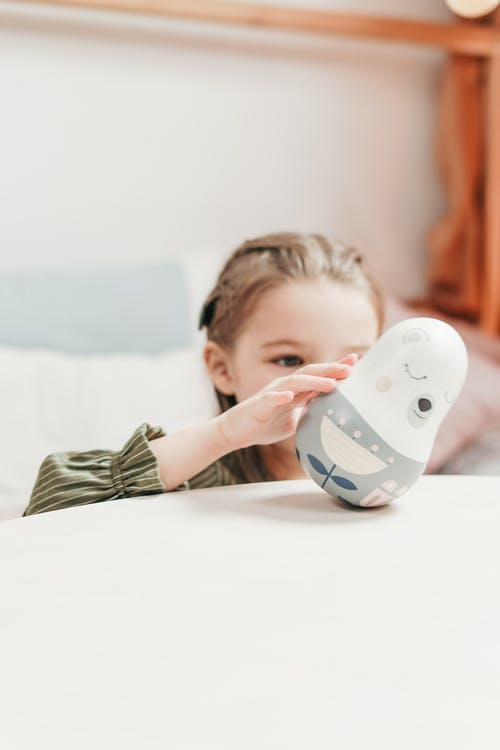 Girl Playing A Plush Toy