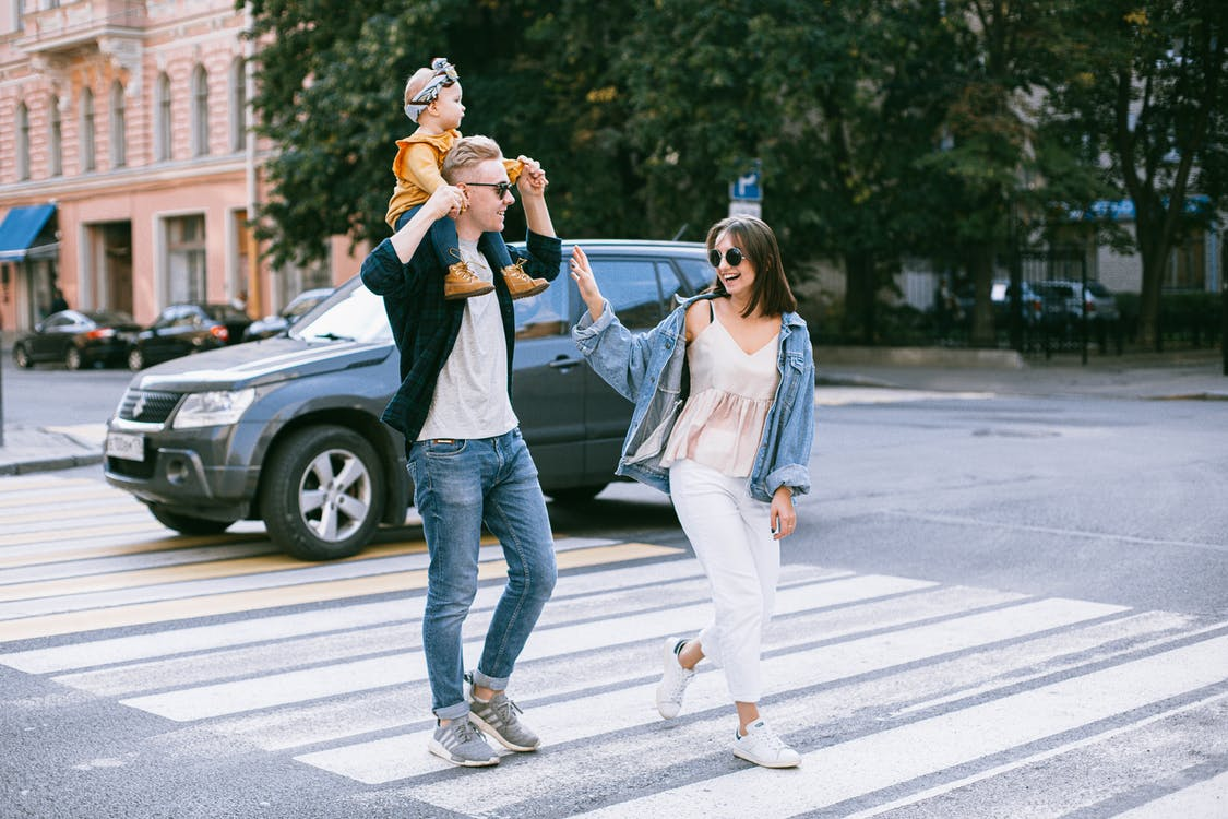 A Photo of a Family Walking in pedestrian lane