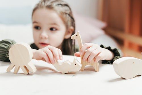 BoyGirl Holding wooden Toys