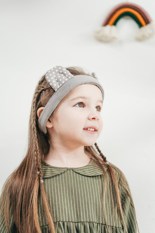 Girl Wearing A Gray Headwear