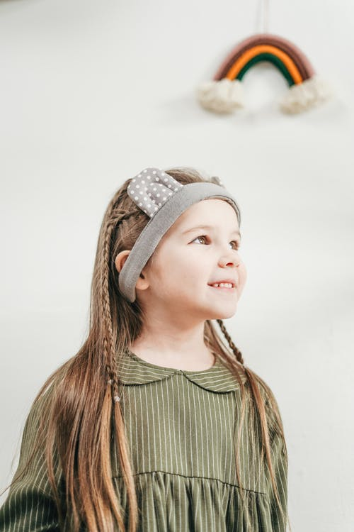 Girl in Green and White Stripe Dress Wearing Gray Head Band