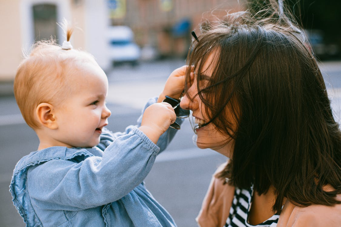 Photo of Woman and Her Daughter Laughing
