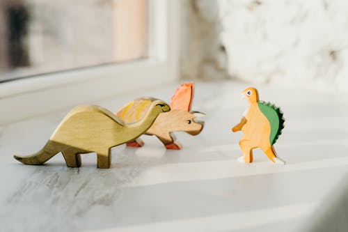 Brown and Green Wooden Animal Figurines