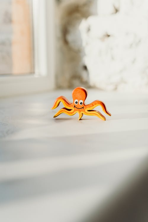 Shallow Focus Photo of Wooden Octopus Toy