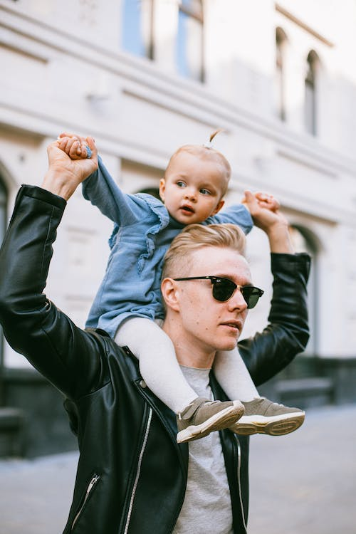 Man In Black Leather Jacket Carrying Baby