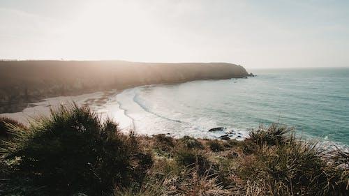 Steep coast with sandy beach of calm ocean