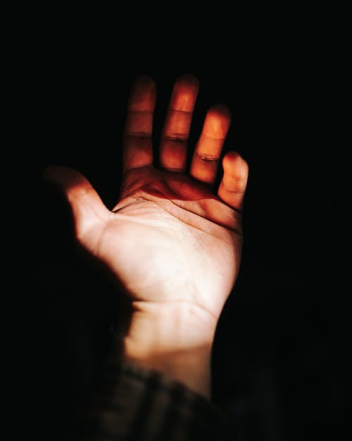 Persons Left Palm on Black Background