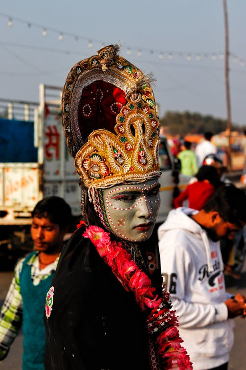 Ethnic man in colorful carnival clothes