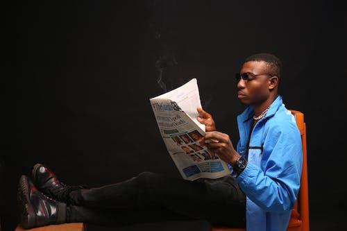A Man Reading A News Paper