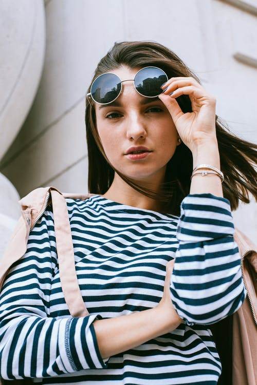 Woman in Blue and White Stripe Shirt Wearing Black Sunglasses