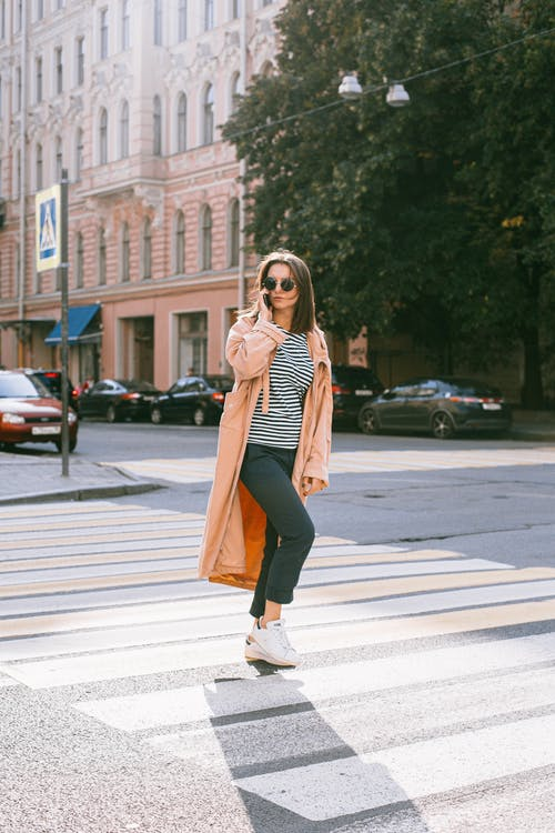 Woman In Striped Shirt Walking In Pedestrian lane