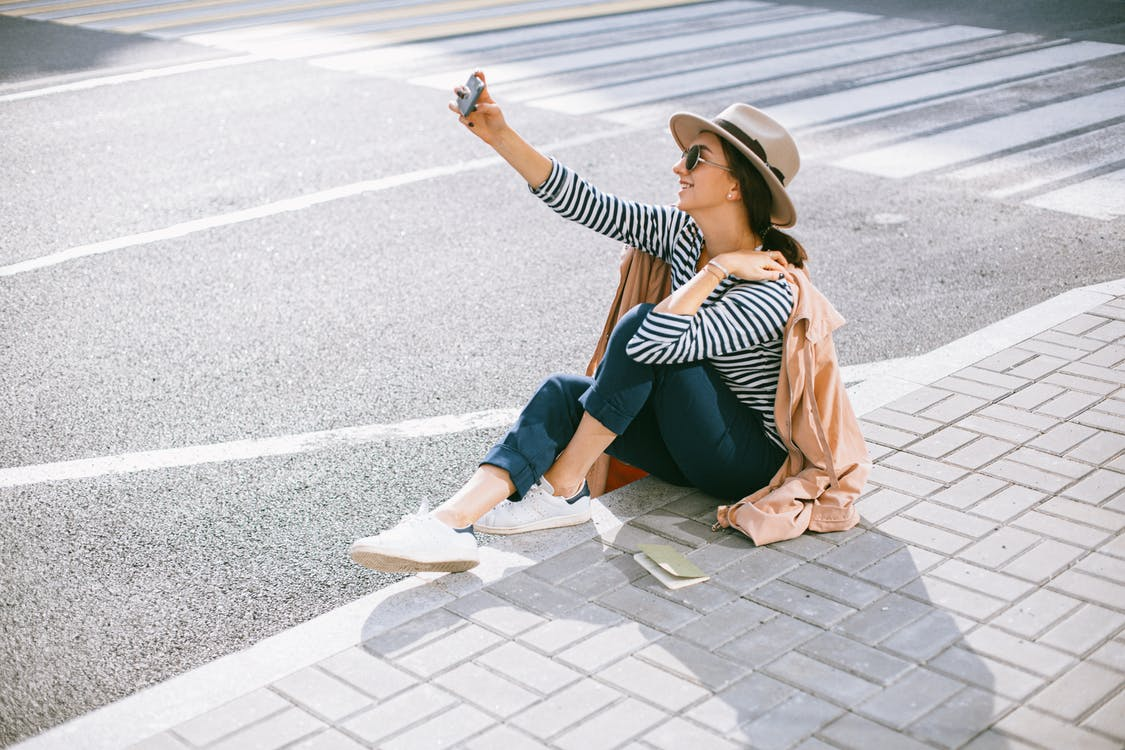 A Woman taking Selfies