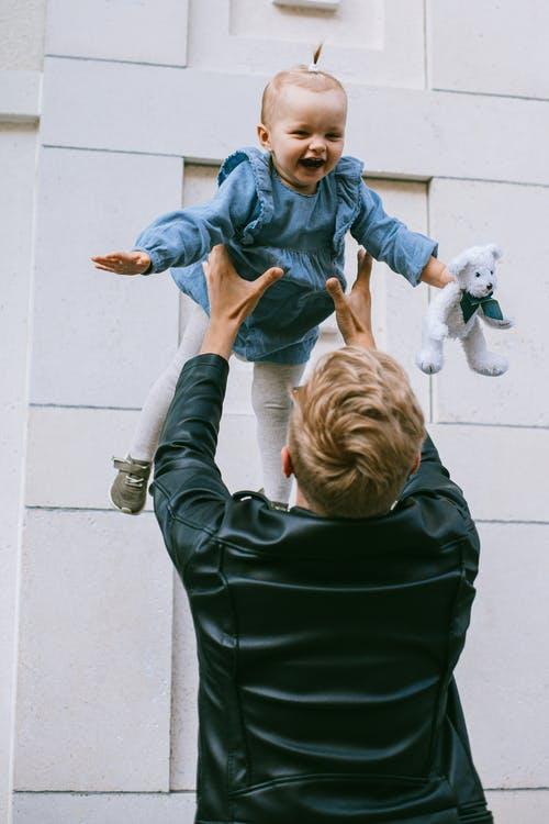 A Father And Child Having Fun
