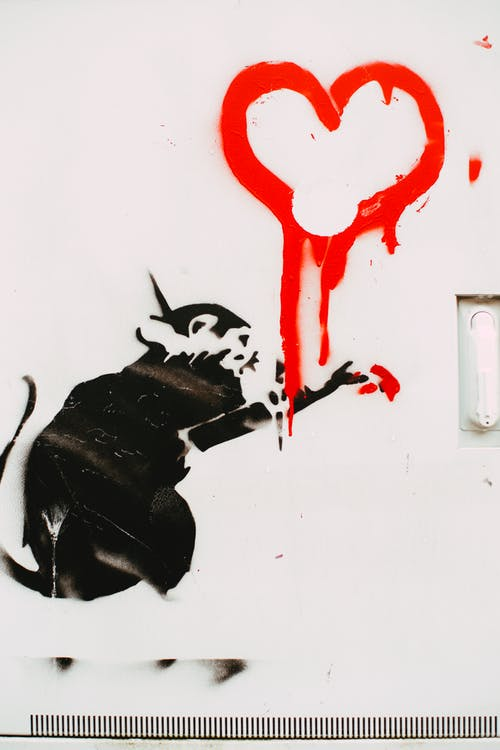 A Red Heart Painted On A White Wall