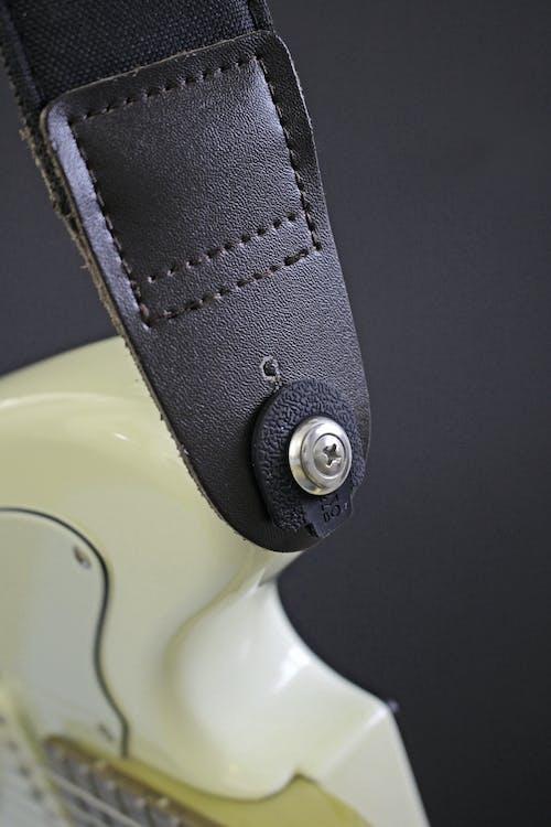 A black Strap Of Electric Guitar