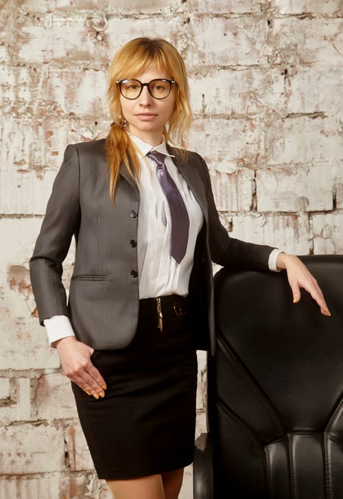 Woman in Black Blazer and Black Dress Skirt Wearing Eyeglasses