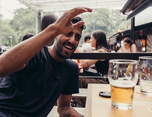 Man in Black Crew Neck T-shirt Raising His Hand