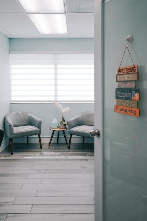 Gray Leather Sofa Chair Beside Glass Window
