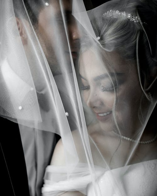 Photo of Woman Covered in White Wedding Veil
